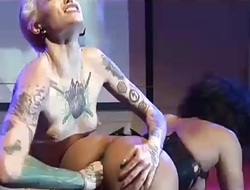 Tattooed fisting sweethearts on porn stage
