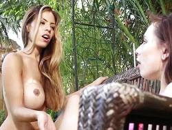 Glamour lesbo models tribbing outdoors