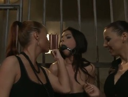 Rude lesbian babes Betty Stylle and Katy Parker are stuffed Maria Belluccis throat with gag tied her to the cage and thrashing her ass.