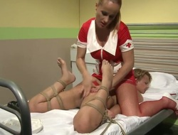 Nasty blonde nurse ties her lesbian patient as this babe licks and rubs her wet juicy muff till this babe cums